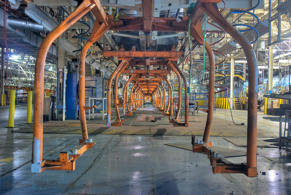 Looking through a line of empty clam shell carriers in the trim shop of the Chrysler Newark main assembly plant, HDR image
