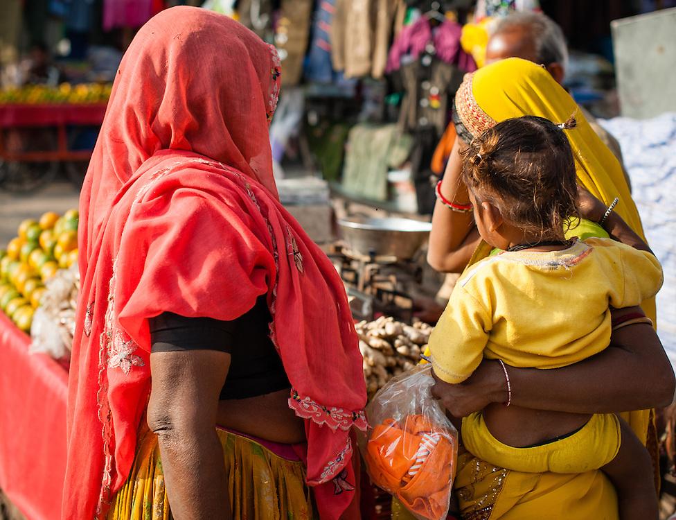 Women in saris shopping at local market (India)