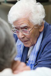 Lady sitting and talking at the Nottingham Royal Society for the Blind (NRSB),