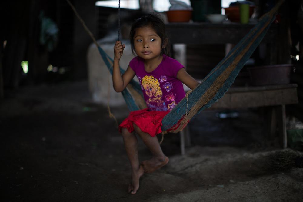 A young girl on a hammock in Sinaí, a Maya Chortí village in Copán, Honduras.