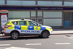 © Licensed to London News Pictures. 02/09/2019. London, UK. A police car is parked outside Elephant and Castle station after two men were found seriously injured following a stabbing last night. A murder investigation has been launched following the death of one of the victims.Photo credit: George Cracknell Wright/LNP