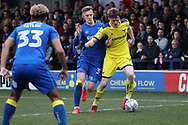 AFC Wimbledon striker Joe Pigott (39) battles for possession with Oxford United defender Rob Dickie (16) during the EFL Sky Bet League 1 match between AFC Wimbledon and Oxford United at the Cherry Red Records Stadium, Kingston, England on 10 March 2018. Picture by Matthew Redman.