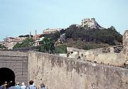 Tour group on Via Victor Hugo beneath historic fort Falcone, Portoferraio, island of Elba, Italy in 1999