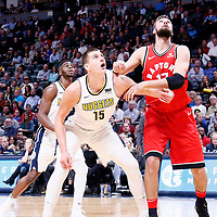 01 November 2017: Denver Nuggets center Nikola Jokic (15) vies for the rebound with Toronto Raptors center Jonas Valanciunas (17) during the Denver Nuggets 129-111 victory over the Toronto Raptors, at the Pepsi Center, Denver, Colorado, USA.