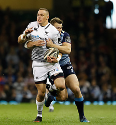 Ospreys' Hanno Dirksen is tackled by Cardiff Blues' Garyn Smith<br /> <br /> Photographer Simon King/Replay Images<br /> <br /> Guinness PRO14 Round 21 - Cardiff Blues v Ospreys - Saturday 28th April 2018 - Principality Stadium - Cardiff<br /> <br /> World Copyright © Replay Images . All rights reserved. info@replayimages.co.uk - http://replayimages.co.uk