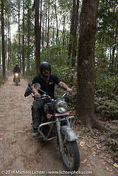 Scotty Busch riding out through the forest from the Kusma Gyadi Bridge on Day-7 of our Himalayan Heroes adventure riding from Tatopani to Pokhara, Nepal. Monday, November 12, 2018. Photography ©2018 Michael Lichter.