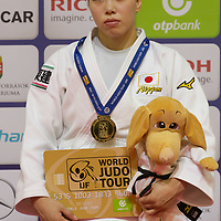 Gold medalist Aimi Nouchi of Japan celebrates her victory during an awards ceremony after the Women -63 kg category at the Judo Grand Prix Budapest 2018 international judo tournament held in Budapest, Hungary on Aug. 11, 2018. ATTILA VOLGYI