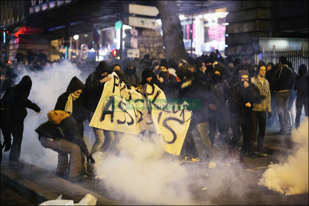 Police fired tear gas after clashes erupted in Paris, France on February 15, 2017, as demonstrators protested over the assault of Theo, a young black man who was allegedly anally raped with a truncheon while being arrested. Projectiles were thrown at police which responded with tear gas. Rape charges have been filed against the officer and all four police involved in Theo's stop-and-search have been suspended pending an investigation. Photo by Frederic Lafargue/ABACAPRESS.COM