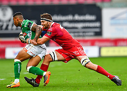 Monty Ioane of Benetton Treviso is tackled by Steven Cummins of Scarlets<br /> <br /> Photographer Craig Thomas/Replay Images<br /> <br /> Guinness PRO14 Round 3 - Scarlets v Benetton Treviso - Saturday 15th September 2018 - Parc Y Scarlets - Llanelli<br /> <br /> World Copyright © Replay Images . All rights reserved. info@replayimages.co.uk - http://replayimages.co.uk