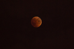 The full moon turns red during total lunar eclipse in Krasnodar, Russia on July 27, 2018. Photo by Nasser Berzane/ABACAPRESS.COM.