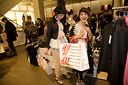 ALICE CARVILL-WHITE; CLAIRE BURROW; , H & M preview of Come Des Garcons for H & M. H & M Regent St. London W1. 12 November 2008.  *** Local Caption *** -DO NOT ARCHIVE-© Copyright Photograph by Dafydd Jones. 248 Clapham Rd. London SW9 0PZ. Tel 0207 820 0771. www.dafjones.com.