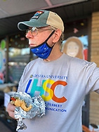 Bellmore, New York, U.S.  September 25, 2021. BOB STUHMER enjoys a sausage hero at the 34th Annual Bellmore Family Street Festival.