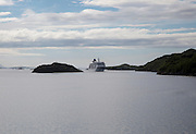 Hurtigruten ferry ship in water of Raftsundet strait of Hinnoya Island, Nordland, northern Norway