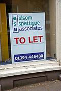 To Let estate agent sign in empty shop window, Elsom Spettigue Associates, Woodbridge, Suffolk, England