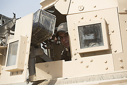 November 11, 2016 - Mosul, Nineveh, Iraq - 11/11/2016. Mosul, Iraq. A soldier, belonging to the Iraqi Army's 9th Armoured Division, peers from the turret of an armoured Humvee as his unit visits Mosul's Al Inisar district on the south east of the city. The Al Intisar district was taken four days ago by Iraqi Security Forces (ISF) and, despite its proximity to ongoing fighting between ISF and ISIS militants, many residents still live in the settlement without regular power and water and with dwindling food supplies...The battle to retake Mosul, which fell June 2014, started on the 16th of October 2016 with Iraqi Security Forces eventually reaching the city on the 1st of November. Since then elements of the Iraq Army and Police have succeeded in pushing into the city and retaking several neighbourhoods allowing civilians living there to be evacuated - though many more remain trapped within Mosul. (Credit Image: © Matt Cetti-Roberts via ZUMA Wire)