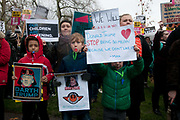 Stop Trump's Muslim ban demonstration on 4th February 2017 in front of the US Embassy in Grosvenor Square, London, United Kingdom. The protest was called on by Stop the War Coalition, Stand Up to Racism, Muslim Association of Britain, Muslim Engagement and Development, the Muslim Council of Britain, CND and Friends of Al-Aqsa. Thousands of demonstrators gathered to demonstrate against Trumps ban on Muslims, saying it must be opposed by all who are against racism and support basic human rights, and for Theresa May not to collude with him. Children hold home-made signs criticising Trump.