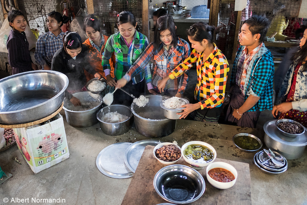 Workers line up to share food at Longyi factory, Myitkyina