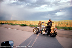 Ghost Rider, WY 1981<br /> <br /> Limited Edition Print from an edition of 50. Photo ©1981 Michael Lichter.<br /> <br /> The Story: Sometimes, when you're out riding alone, you find yourself side by side with another rider without knowing who they are, where they come from or where they're going.  I figured this person was also heading to Sturgis in 1981, but I'll never know for sure.  I doubt he has any idea this photo exists; just a scribbled note about a moment in time. With a little nod, I pulled off for gas never to know his identity.