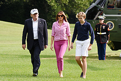 U.S. President Donald Trump , First Lady Melania Trump and Barron Trump return to the White House on August 27, 2017 in Washington, DC. . Photo by Olivier Douliery/ Abaca