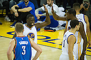 Golden State Warriors forward Draymond Green (23) celebrates with forward Kevin Durant (35) after a blocked shot against the Oklahoma City Thunder at Oracle Arena in Oakland, Calif., on November 3, 2016. (Stan Olszewski/Special to S.F. Examiner)