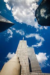 Thanksgiving Square Chapel framed against Gables Republic Tower, Dallas, Texas, USA.