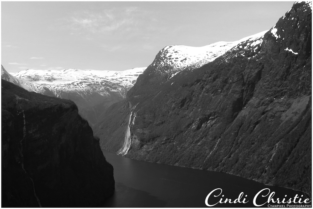 Waterfalls from melting snow cascade off the mountainsides at Geiraingerfjord  on May 18, 2013.  Geirangerfjord is among UNESCO World Heritage sites.  (© 2013 Cindi Christie)
