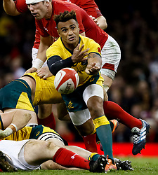 Will Genia of Australia gets the ball away<br /> <br /> Photographer Simon King/Replay Images<br /> <br /> Under Armour Series - Wales v Australia - Saturday 10th November 2018 - Principality Stadium - Cardiff<br /> <br /> World Copyright © Replay Images . All rights reserved. info@replayimages.co.uk - http://replayimages.co.uk