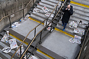 As Londoners are told to remain at home and therefore few commuters taking newspapers for their homeward journeys, copies of the Evening Standard blow down the steps of Bank Underground station during the third lockdown of the Coronavirus pandemic, in the City of London, the capitals financial district, aka The Square Mile, on 2nd February 2021, in London, England.