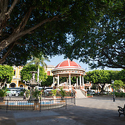 Parque Central is the main square and the historic heart of Granada, Nicaragua. The park has a number of monuments, fountains, with many ficus trees providing shade.