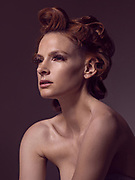 Editorial Fashion Photography using Profoto B1 lights. Black reflectors were used on the side of the portrait. Profoto Barn doors were used to control the light fall. Shot with Phaseone IQ 250