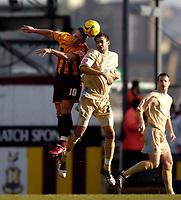 Photo: Jed Wee.<br />Bradford City v Bristol City. Coca Cola League 1. 18/02/2006.<br />Bradford's Dean Windass (L) jumps with Bristol's Liam Fontaine.