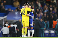 Goalkeeper Iker Casillas of FC Porto hugs Pedro of Chelsea after the final whistle. UEFA Champions league group G match, Chelsea v Porto at Stamford Bridge in London on Wednesday 9th December 2015.<br /> pic by John Patrick Fletcher, Andrew Orchard sports photography.