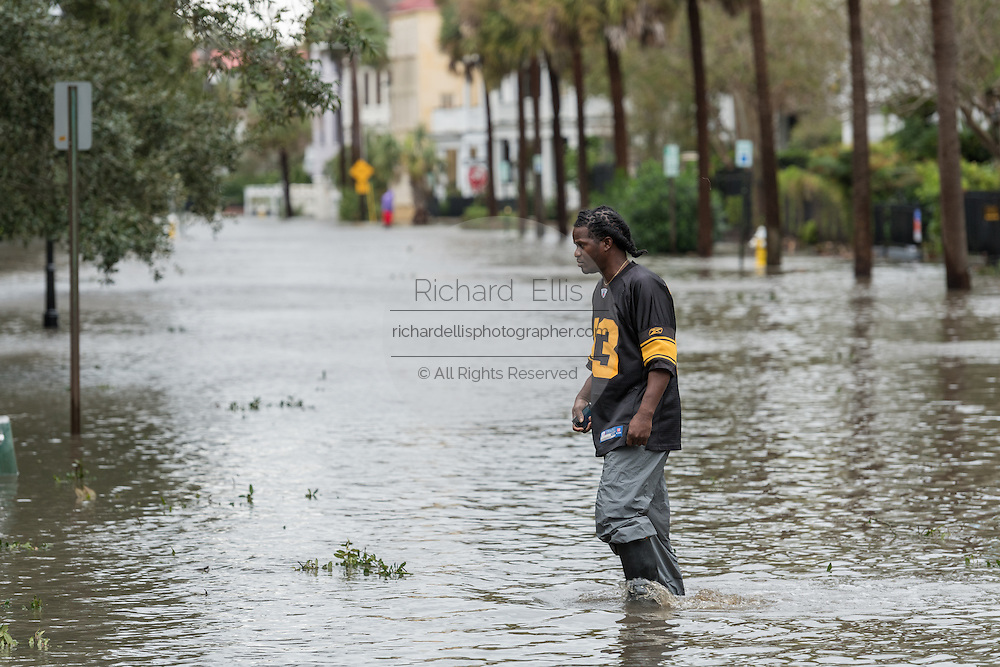 A young man wades through flood waters on South Battery Street in historic downtown after Hurricane Matthew passed through causing flooding and light damage to the area October 8, 2016 in Charleston, South Carolina. The hurricane made landfall near Charleston as a Category 2 storm but quickly diminished as it moved north.