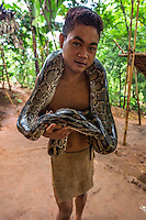 Palawan Tribe Boy with Python -  The Palawano tribal people, also known as the Palawan or the Pala'wan tribe, are an indigenous ethnic group in Palawan. Palawanos have not been very assimilated into Filipino society and few speak Tagalog. Typically they keep to themselves in thier mountainous enclaves. Palawanos are a  vulnerable tribe because they lack basic education even today.  Activists claim that the government wants to keep the Palawan tribe in a primitive state as a tourist attraction. The Palawano diet is made up of rice, bananas, cassava, breadfruit, pork from wild pig, fruit andfreshwater fish.