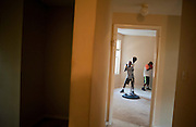 Sep 1, 2010 - Washington, District of Columbia, U.S., - Young boys and a girl learn boxing from coach Odell Montgomery in a vacant apartment in northeast Washington, D.C. (Credit Image: © Pete Marovich/ZUMA Press)
