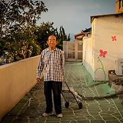 A man poses for a portrait along a hillside path in Sasang-gu, Busan, South Korea.