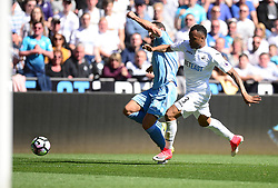 Jordan Ayew of Swansea City battles for the ball with Erik Pieters of Stoke City - Mandatory by-line: Alex James/JMP - 22/04/2017 - FOOTBALL - Liberty Stadium - Swansea, England - Swansea City v Stoke City - Premier League