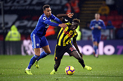 Watford's Domingos Quina (right) and Cardiff City's Josh Murphy battle for the ball during the Premier League match at Vicarage Road, Watford.
