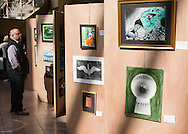 """Town of Wallkill, New York - A man looks at art on exhibit at the Orange County Arts Council All-County High School Arts Display at the Galleria at Crystal Run on Feb. 28, 2015. The theme of the event was: """"Arts Build Confidence""""."""