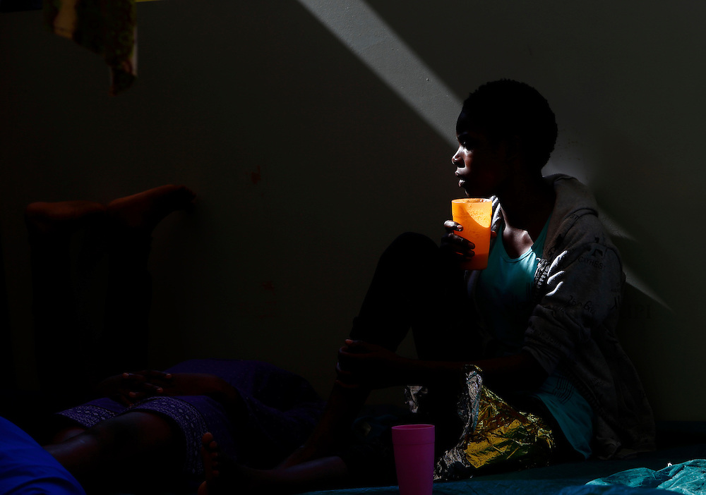 A migrant drinks water on the deck of the Medecins san Frontiere (MSF) rescue ship Bourbon Argos somewhere between Libya and Sicily August 8, 2015.  Some 241 mostly West African migrants on the ship are expected to arrive on the Italian island of Sicily on Sunday morning, according to MSF.<br /> REUTERS/Darrin Zammit Lupi <br /> MALTA OUT. NO COMMERCIAL OR EDITORIAL SALES IN MALTA