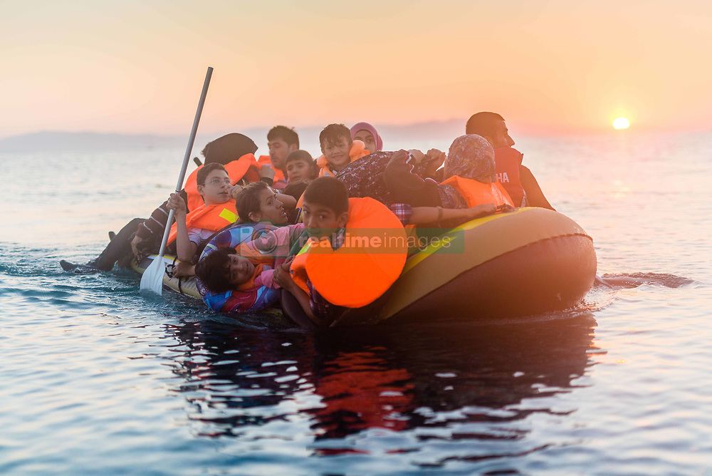 Aug. 28, 2015 - Kos, greece - Syrian family arriving on 30th August 2015 in Kos Island, Greece...Kos on the brink as Mediterranean refugee crisis continues with many boats arriving each night from Turkey. It is small trip, only 3 miles, but for refugees from Syria, Pakistan, Bangladesh, Iraq etc. who can't swim it is one of the scariest part of their trip which most are hoping will end in Germany. (Credit Image: © Ulrik Pedersen/NurPhoto via ZUMA Press)