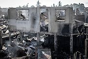 April 7, 2014 - Kawit, Philippines - <br /> <br /> Deadly Fire Razes 500 Houses in Kawit<br /> <br /> A resident stands in the doorway of his burned house in Kawit town, Cavite province, Philippines. Three children and an elderly woman were killed in a fire which razed 500 houses and left 1000 families without homes, according to residents. <br /> ©Exclusivepix