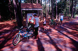 Visitors check the map as they cycle at Cape Henlopen State Park in Rehoboth Beach, Del., Tuesday, Aug. 20, 2019. (Photo by D. Ross Cameron)