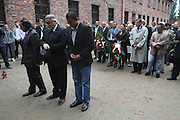 """Roma Holocaust 67th anniversary. Attended by Roma survivors and families of survivors and victims. Commemoration at Wall of Death, where many Roma were shot by firing squad. Auschwitz, Oswiecim Poland..Roma Holocaust """"Porrajmos"""", the Roma word means literally """"the devouring"""", where it is estimated that between 500 thousand and one and a half million Roma were exterminated across Germany, Poland, ex-Yugoslavia and Czechoslovakia during the 1930s and 1940s. The Roma were the first race to be subjected to experimentation by the Nazis, as part of Joseph Goebbels' 'Final Solution'."""