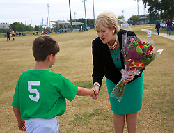 08 November 2014. New Orleans, Louisiana. <br /> Heather Humphreys, Irish Fine Gael politician and the Minister for Arts, Heritage and the Gaeltacht pays a visit to Carrolton Boosters Soccer Club. Humphreys was met by players from the U10 Team Ireland.<br /> Photo; Charlie Varley/varleypix.com