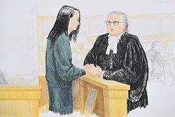 In this courtroom sketch, Meng Wanzhou, left, the chief financial officer of Huawei Technologies speaks to her lawyer David Martin during a bail hearing at B.C. Supreme Court in Vancouver, BC, Canada on Monday, December 10, 2018. Photo by Jane Wolsak/CP/ABACAPRESS.COM