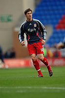 Photo: Paul Greenwood.<br />Wigan Athletic v Liverpool. The Barclays Premiership. 02/12/2006. Xabi Alonso warms up before the game