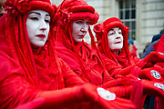 Climate change protest art group The Red Brigade perform in Whitehall on 7th October, 2019 in London, Untited Kingdom. Extinction Rebellion plan to occupy 12 sites situated around key Government locations around Westminster for two weeks to protest against climate change. (photo by Claire Doherty/In Pictures via Getty Images)