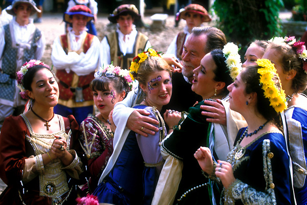 Stock photo of a man with a group of women in costume at the Texas Renaissance Festival in Plantersville Texas