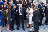 07 JUL 2017, HAMBURG/GERMANY:<br /> Kim Jeong-suk, Ehefrau von Moon Jae-in, Juliana Awada, Ehefrau von Mauricio Macri, Mauriocio Macri, Praesident von Argentinien, Donald Tump, Praesident Vereinigte Staaten von Amerika, USA, Peng Liyuan Ehefrau von Xi Jinping, Melania Trump, Ehefrau von Donald Trump, Angela Merkel, CDU, Bundeskanzlerin, Joachim Sauer, Ehemann von Angela Merkel, (v.L.n.R.), Merkel weist Trump seine Platz in der zweiten Reihe zu, Familienfoto der G20 Teilnehmer und ihrer Partner vor der Elbphilharmonie<br /> IMAGE: 20170707-02-007<br /> KEYWORDS: G20 Summit, Deutschland, Elphi
